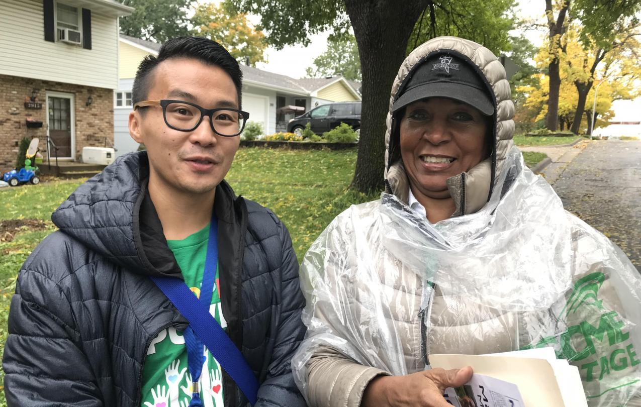 Member Organizers David Yang (Local 34) and Starr Suggs (Local 3142) knock doors in Richfield, Minnesota